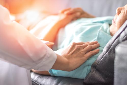 elderly women in hospital bed