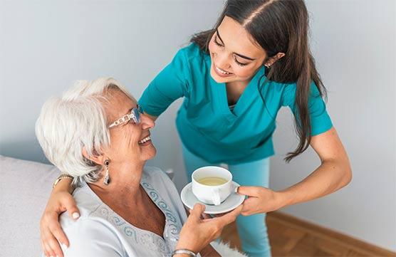 AHHC Home Health Caregiver Helping Elderly Women